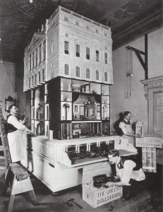 Packing up the dolls house to deliver to Queen Mary - 1924